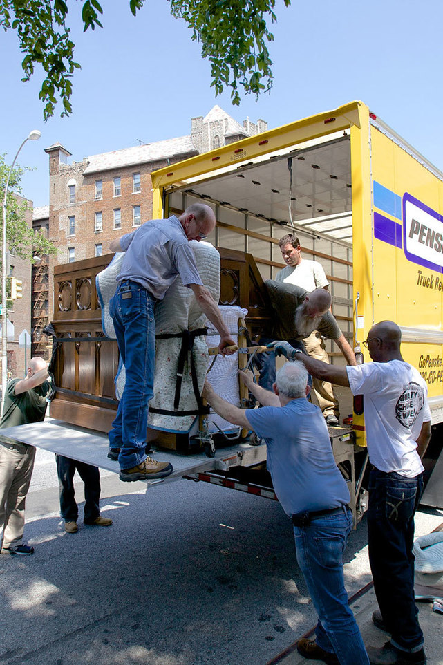Unloading 2 trucks with the restored pipe organ into Our Lady of Refuge in Brooklyn.